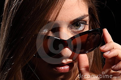 Young woman with sexy look in dark sunglasses