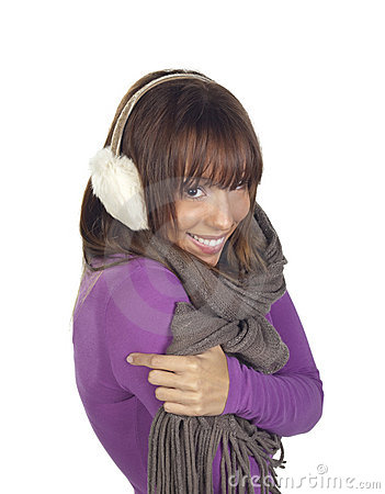 Young woman shivering wearing ear muffs and scarf