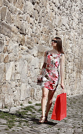 Young Woman with Shopping Bag in a City Street