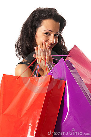 Young woman with shopping bags close-up