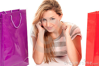 Young woman with shopping bags lying on floor
