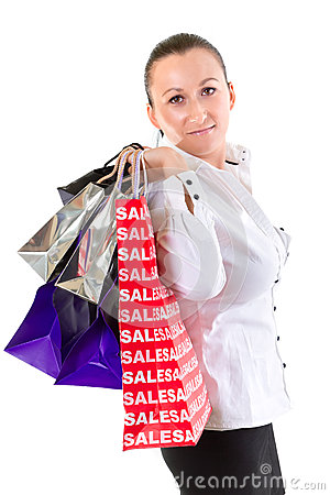 Young woman with shopping bags over white