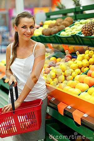 Young woman shopping in a supermarket in the department of fruit Stock Photo