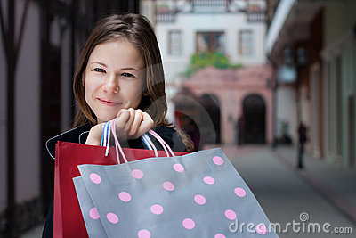 Young woman with shoppingbags