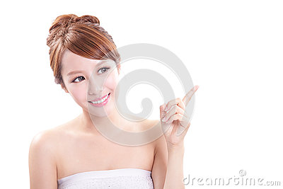 Young woman showing beauty product
