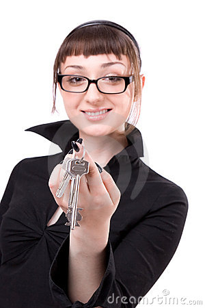 Young woman showing key