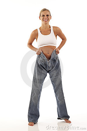 Young woman showing off weight loss
