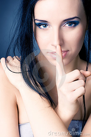 Young woman showing quiet sign
