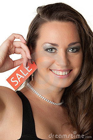 Young woman showing SALE sign