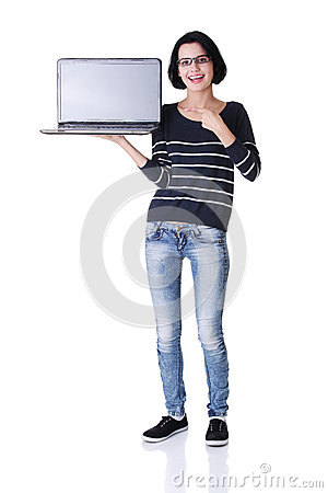 Young woman showing screen of 17 inch laptop