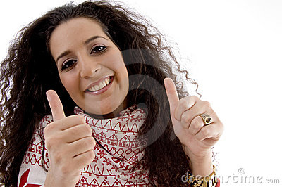 Young woman showing thumb up with both hands