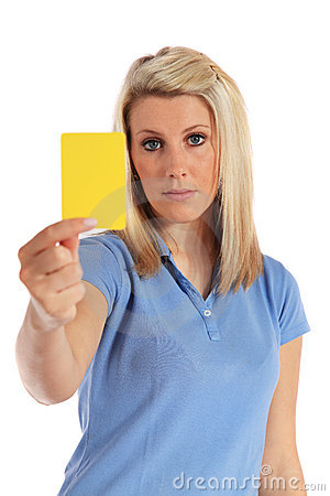 Young woman showing a yellow card