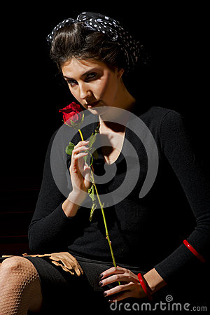 Young woman with single red rose