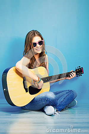 Young woman sings and playing guitar stock photo image 44430841