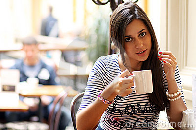 Young woman sipping coffee