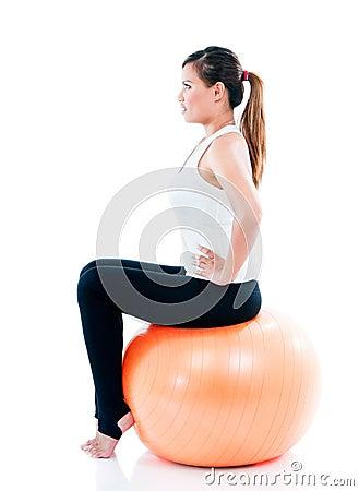 Young Woman Sitting On Balance Ball