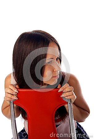 Young woman is sitting on the chair