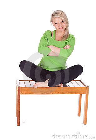 young woman sitting with crossed legs royalty free stock