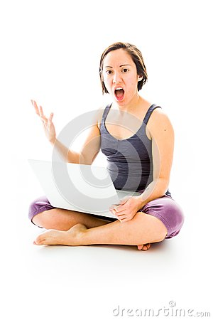 Young woman sitting on floor using laptop with looking frustrate