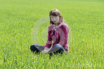 Young Woman sitting on grass