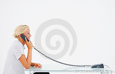 Young woman sitting isolated and speaking on phone