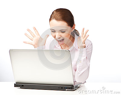 Young woman sitting at a laptop, screaming