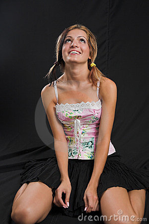 Young woman sitting and looking up