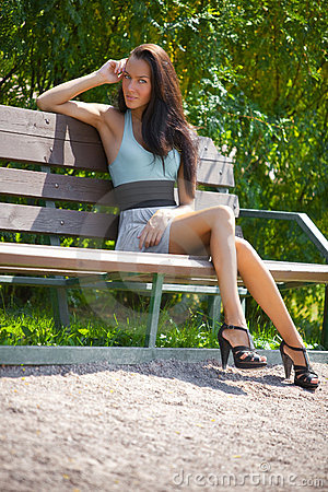 Free Young Woman Sitting On A Bench Royalty Free Stock Image - 10434396