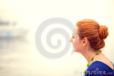 Young woman sitting on a pier