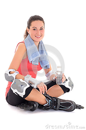 Young woman sitting with rollers on legs and bottle of water