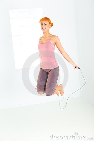 Young woman skipping rope