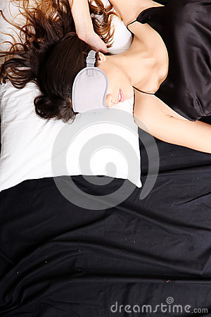 Young woman sleeping with Eyeshades