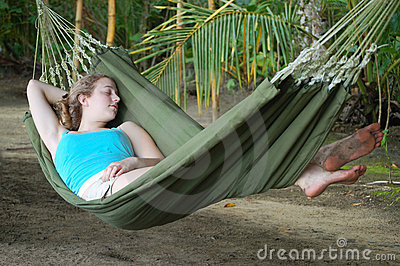 Young woman sleeping in a hammock