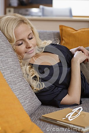 Young woman sleeping at home