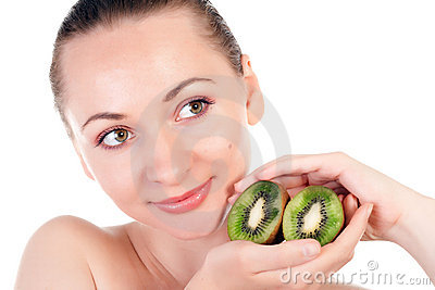Young woman with slices of kiwi