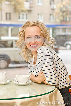 Young woman at small cafe