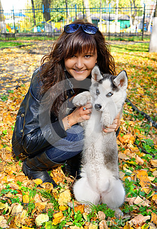 Young woman and  small dog siberian husky