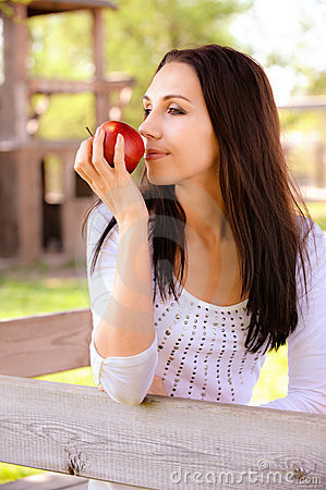 Young woman smell apple