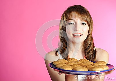 Young woman smelling cookies