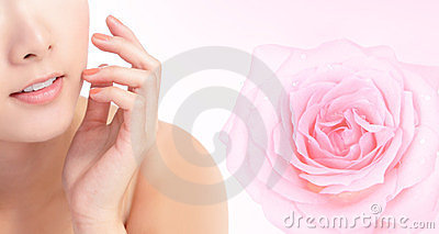 Young woman smile mouth with pink rose flower