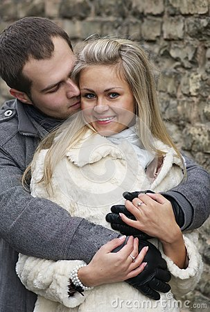 Young Woman Smiles In The Arms Of Her Boyfriend