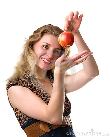 Young woman smiles  holding an apple