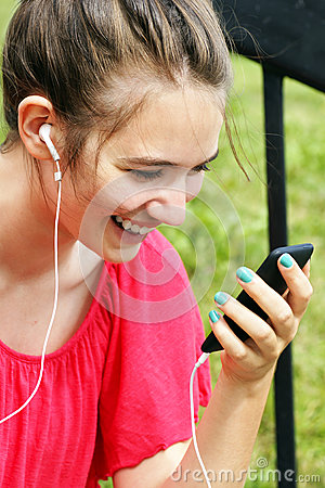 Young woman smiling at phone