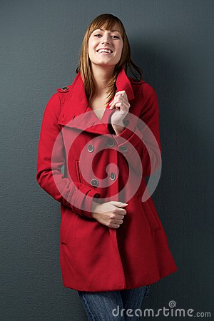 Young woman smiling in red winter jacket