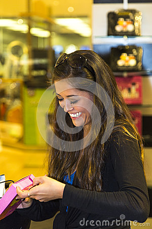 Young Woman Smiling While Shopping