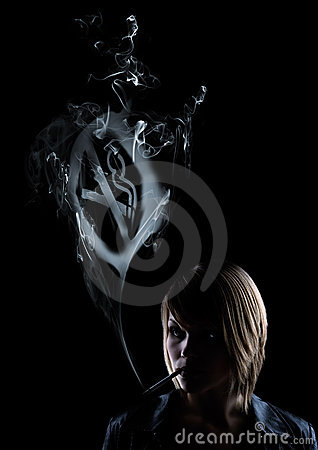 Young woman smokes a No Smoking Sign
