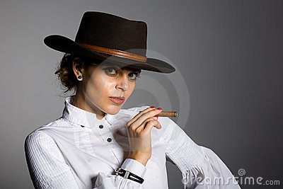 Young woman smoking a cigar.