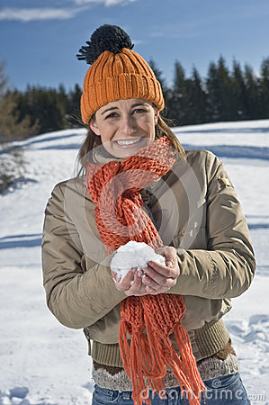 Young woman with snow ball