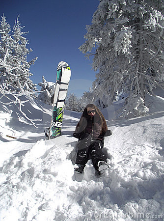 Young woman with a snowboard