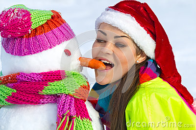 Young woman with a snowman